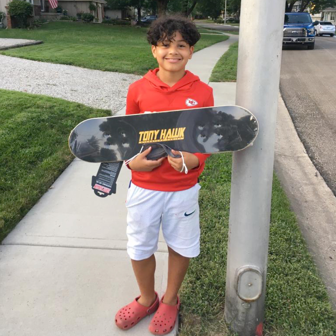 Payton holding up a skateboard we donated to him.  His uncle reached out to us letting us know that his nephew is an avid skateboarder and wanted to know if we could provide him with a new skateboard.